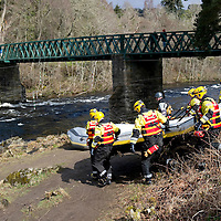 Canoeist Dies in River Tay Tradegy at Grandtully, Perthshire....08.04.10<br /> Firefighters prepare to enter the raging waters of the River Tay to put holes in the canoe in an attempt to free the canoe from the submerged rocks.<br /> Picture by Graeme Hart.<br /> Copyright Perthshire Picture Agency<br /> Tel: 01738 623350  Mobile: 07990 594431