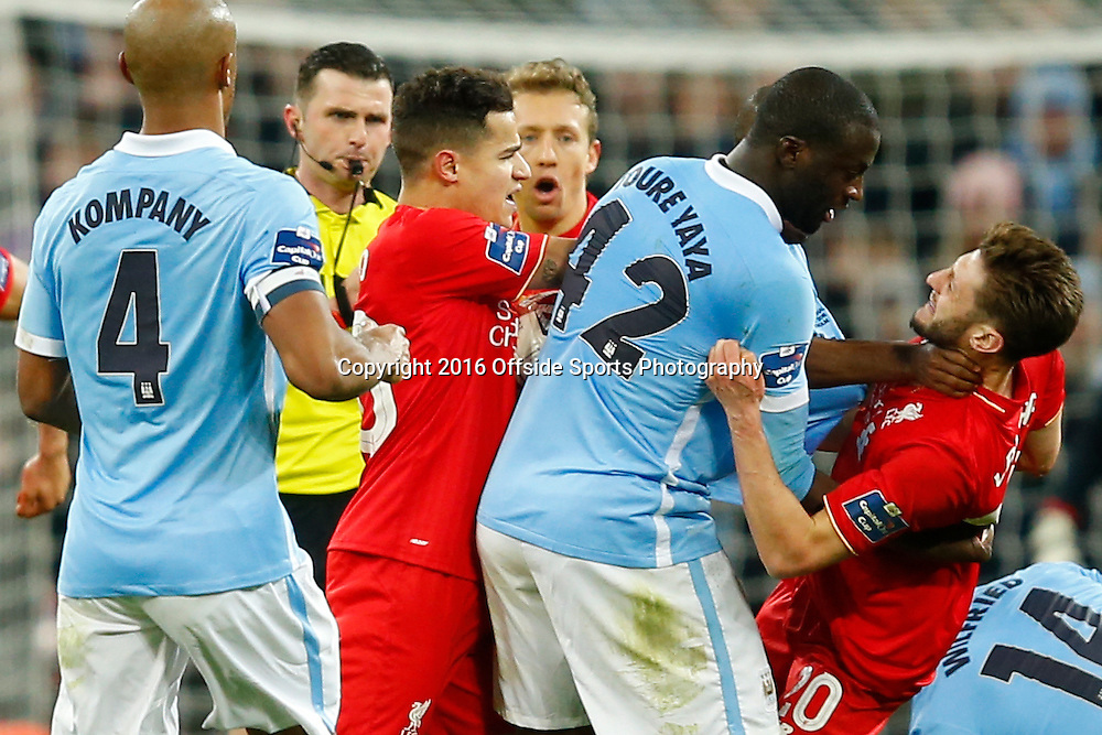 28 February 2016 - The Capital One Cup Final - Liverpool v Manchester City - Adam Lallana of Liverpool clashes with Yaya Toure of Manchester City  - Photo: Marc Atkins / Offside.