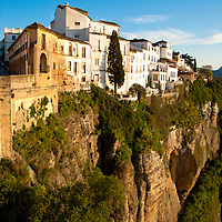 View from the puente nuevo (the ' new bridge' , finished 1793) on the line of houses that live on the cliff of El Tajo canyon, 390ft above the Guadalevìn River on it's floor.