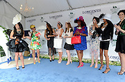 Ashley Lauren Kerr, left, of Maine, reacts after winning the Longines Most Elegant Woman fashion contest, Saturday, June 11, 2016, at Belmont Park in Elmont, NY. Longines, the Swiss watchmaker known for its elegant timepieces, is the Official Watch and Timekeeper of the 148th running of the Belmont Stakes. (Diane Bondareff/AP Images for Longines)