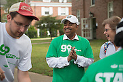 Ohio University President Roderick McDavis (Center) and volunteer Nick Downing (Left) help first year students and their families move into their residence halls on East Green. Photo by Ben Siegel