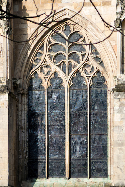 14th century traceried window in the decorated style with leaf motif, in the south aisle of Beverley Minster, Yorkshire, UK