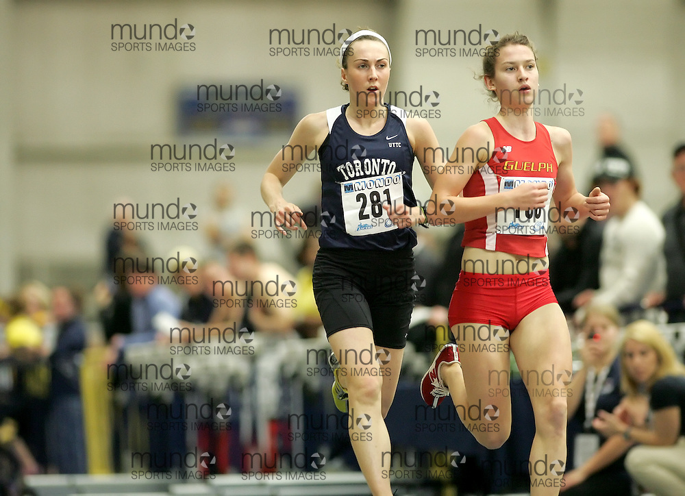 (Windsor, Ontario---12 March 2010) Megan Brown of University of Toronto tracks down a Guelph runner en-route to a silver medal in the 3000m to go with the silver she earned in the 1000m an hour earlier at the 2010 Canadian Interuniversity Sport Track and Field Championships at the St. Denis Center. Photograph copyright Sean Burges/Mundo Sport Images. www.mundosportimages.com
