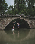 Alex, Pablo, Javier, and Guido, local 18-year-olds, jump from the Puente de Iturgaiz into the Arga River in Irotz, Spain. The Camino de Santiago crosses the bridge. (May 30, 2018)<br /> <br /> DAY 3: ZUBIRI TO PAMPLONA -- 21 KM