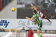 Paul Robinson of AFC Wimbledon and Jamie Reid of Exeter City tangle during the Sky Bet League 2 match between Exeter City and AFC Wimbledon at St James' Park, Exeter, England on 28 December 2015. Photo by Stuart Butcher.