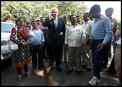 Boris Johnson during a live interview on his mobile. Later he will come up against India's equivalent of David Letterman today as he appears on one of the country's most famous current affairs programmes. The London mayor, who will round off the tour of India to promote business links with the capital, will also visit the Bombay stock exchange before he appears on Times Now with Arnab Goswami. Goswami is one of India's most prominent chat show hosts and has also interviewed Gordon Brown, Hillary Clinton and Sonia Gandhi.  Friday November 30, 2012. Photo by Andrew Parsons / i-Images
