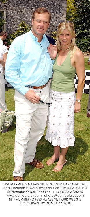 The MARQUESS & MARCHIONESS OF MILFORD HAVEN, at a luncheon in West Sussex on 14th July 2002.PCB 123