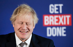 © Licensed to London News Pictures. 29/11/2019. London, UK. Prime Minister Boris Johnson briefly closes his eyes as he answers questions at a press conference in London. Later a seven way TV election debate will take place with senior politicians in Cardiff. Photo credit: Peter Macdiarmid/LNP
