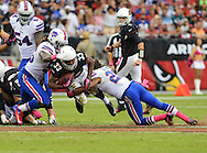 Oct. 14, 2012; Glendale, AZ, USA;  Arizona Cardinals running back William Powell (33) is tackled by Buffalo Bills cornerback Stephon Gilmore (27)  during the game against the Buffalo Bills at University of Phoenix Stadium. The Bills defeated the Cardinals 19-16 in overtime. Mandatory Credit: Jennifer Stewart-US PRESSWIRE..