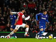 Picture by Mike  Griffiths/Focus Images Ltd +44 7766 223933<br /> 01/01/2014<br /> Mikel Arteta of Arsenal and Kim Bo-Kyung of Cardiff City during the Barclays Premier League match at the Emirates Stadium, London.