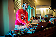 DUBAI, UAE - DECEMBER 18, 2015: A DJ is playing a set during brunch at the Saffron restaurant, West Tower, Atlantis The Palm, The Palm Jumeirah. The hours following brunch may bring high energy and dancing.