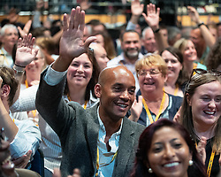 © Licensed to London News Pictures . 14/09/2019. Bournemouth, UK. CHUKA UMUNNA lifts his hand in the air as Jo Swinson calls on members of the audience to raise their hands if it is their first Lib Dem conference .The first day of the Liberal Democrat Party Conference at the Bournemouth International Centre . Photo credit: Joel Goodman/LNP