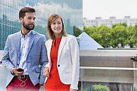 Attractive businessman and businesswoman standing outside office building