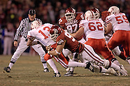 University of Oklahoma defensive end C.J. Ah You (99) sacks Nebraska quarterback Zac Taylor (13) in the first quarter during the Big 12 Championship game at Arrowhead Stadium in Kansas City, Missouri, December 2, 2006.  The Sooners lead at half 14-7.<br />