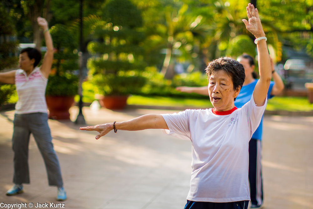 11 APRIL 2012 - HO CHI MINH CITY, VIETNAM: Women exercise in a dance class in a small park in Ho Chi Minh City, Vietnam. It's not unusual to see many older people working out and exercising in parks in Vietnam early in the morning. Ho Chi Minh City, formerly Saigon, is the largest city in Vietnam and the country's commercial center. It was the capital of South Vietnam before the reunification in 1975 and still shows more signs of American influence than northern Vietnam does.    PHOTO BY JACK KURTZ