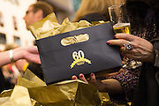 Guests receive a City of Milpitas 60th Anniversary gift bag during the City of Milpitas 60th Anniversary Gala at Milpitas City Hall in Milpitas, California, on January 25, 2014. (Stan Olszewski/SOSKIphoto)
