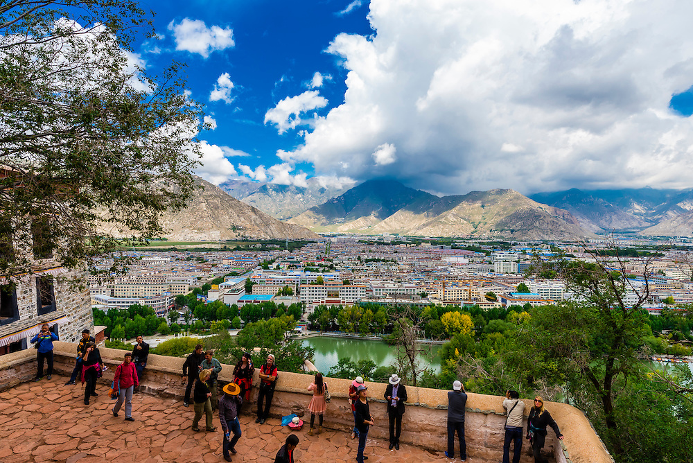 Overview of the Lhasa skyline from the Potala Palace (a UNESCO World Heritage Site) was the chief residence of the Dalai Lama until the 14th Dalai Lama fled to Dharamsala, India, during the 1959 Tibetan uprising. The massive palace contains 999 rooms. Lhasa, Tibet, China.