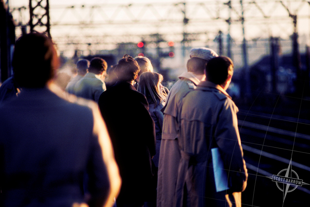 Commuters waiting for train on platform.