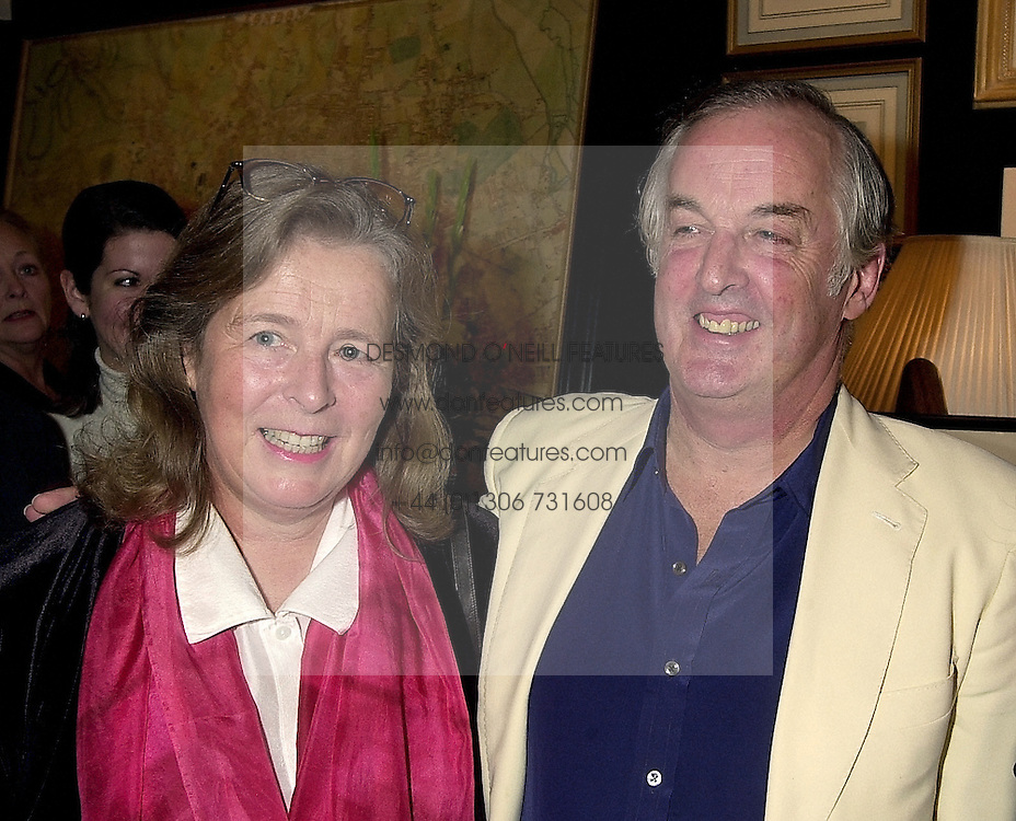 SIR & LADY CHRISTOPHER BLAND at an exhibition in London on 16th November 2000.OJF 45