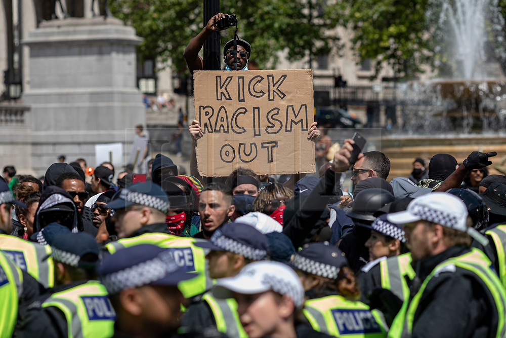 © Licensed to London News Pictures. 13/06/2020. London, UK. Black Lives Matter and right-wing protesters clash in Trafalgar Square. Protests have taken place across the United States and in cities around the world in response to the killing of George Floyd by police officers in Minneapolis on 25 May. Photo credit: Rob Pinney/LNP