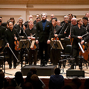"""March 27, 2012 - New York, NY : Music Director and Conductor Michael Tilson Thomas, on podium, takes a bow after leading the San Francisco Symphony in Edgard Varèse's """"Amériques"""" in Carnegie Hall's Stern Auditorium on Tuesday evening.  CREDIT : Karsten Moran for The New York Times"""