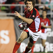 Canada's Taylor Paris contributed his 1st half try as his team routed Uruguay 29-0 at the USA Sevens, Las Vegas, Nevada, USA.  Photo by Barry Markowitz, 2/11/12