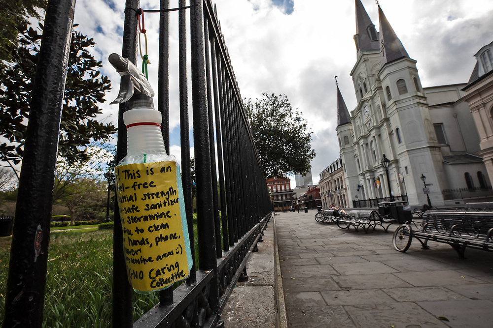 Free sanitizer tied to the fence in Jackson square across from St. Louis Cathedral in New Orleans French Quarter. The city and State are under a stay at home order due to the COVID-10 pandemic, however some of the city's homeless population are living on the streets of the French Quarter. New Orleans , major city, USA