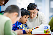 Parent helper with children at a preschool for gifted children