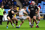 Exeter Chiefs lock Jonny Hill  is held up by Wasps wing Josh Bassett during the Aviva Premiership match between Wasps and Exeter Chiefs at the Ricoh Arena, Coventry, England on 18 February 2018. Picture by Dennis Goodwin.
