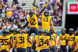 Sep 22, 2018; Morgantown, WV, USA; West Virginia Mountaineers wide receiver David Sills V (13) and West Virginia Mountaineers wide receiver Gary Jennings Jr. (12) celebrate before their game against the Kansas State Wildcats at Mountaineer Field at Milan Puskar Stadium. Mandatory Credit: Ben Queen-USA TODAY Sports