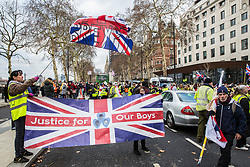 London, UK. 2nd February, 2019. Supporters of Yellow Vests UK block the Victoria Embankment outside New Scotland Yard during a protest to call for 'British people to be put first', for a 'full Brexit' and for 'an end to government, court and banking corruption'.