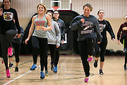 Alex Caldwell, front right, does drills at track practice at St. John Fisher College on Friday, November 7, 2014.