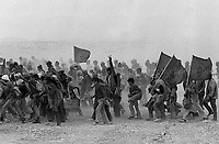 Thousands of Moroccan men seen on the Green March in the Western Sahara in November 1975. The march was to reclaim the territory from the Spanish. Photographed by Terry Fincher