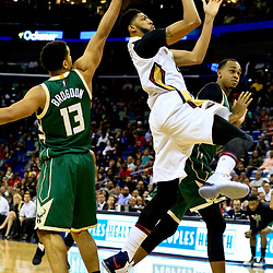 Nov 1, 2016; New Orleans, LA, USA; New Orleans Pelicans forward Anthony Davis (23) shoots over Milwaukee Bucks guard Malcolm Brogdon (13) and  forward John Henson (31)during the second half of a game at the Smoothie King Center. Mandatory Credit: Derick E. Hingle-USA TODAY Sports
