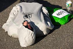 runner relaxes in athlete village before race