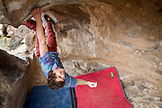 Kevander Baldwin nearly loses his grip as his friends make jokes while he climbs The Fang, v4.<br /> Sad Boulders, California