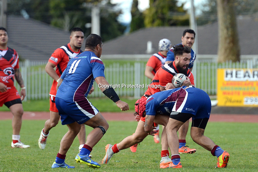 Counties' George Edwards being tackled by Akarana's forwards during the New Zealand Rugby League Competition, Counties Manukau Stingrays v Akarana Falcons. Auckland, New Zealand on Saturday 26 September 2015. Copyright Photo: Raghavan Venugopal / www.photosport.nz
