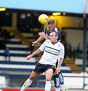 Dundee's Daryll Meggatt heads clear under pressure from Raith's Mark Stewart - Raith Rovers v Dundee, pre-season friendly at Starks Park<br /> <br />  - &copy; David Young - www.davidyoungphoto.co.uk - email: davidyoungphoto@gmail.com