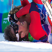 Winter Olympics, Vancouver, 2010.Petter Northug, Norway, left, (on ground), is congratulated by team mate Oeystein Pettersen after winning the Gold Medal ahead of German in the Men's Team Sprint Free at Whistler Olympic Park , Whistler, during the Vancouver Winter Olympics. 22nd February 2010. Photo Tim Clayton