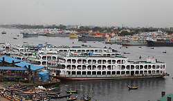 May 30, 2017 - Dhaka, Bangladesh - May 30, 2017 - Dhaka, Bangladesh – All launch anchor at the Sdarghat launch terminal in Dhaka, Bangladesh on 30 May, 2017. All river transports have been suspended as Cyclone Mora is bearing down on Chittagong and Cox's Bazar coasts. According to the Bangladesh Meteorological Department Cyclone Mora has hit the Bangladesh coast with heavy winds and rain, damaging houses and trees on St Martin's Island, Kutubdia, Teknaf and Cox's Bazar town in its wake.© Monirul Alam (Credit Image: © Monirul Alam via ZUMA Wire)