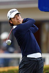 Feb 12, 2012; Pebble Beach CA, USA; Kevin Na hits his tee shot on the first hole during the final round of the AT&T Pebble Beach Pro-Am at Pebble Beach Golf Links. Mandatory Credit: Jason O. Watson-US PRESSWIRE