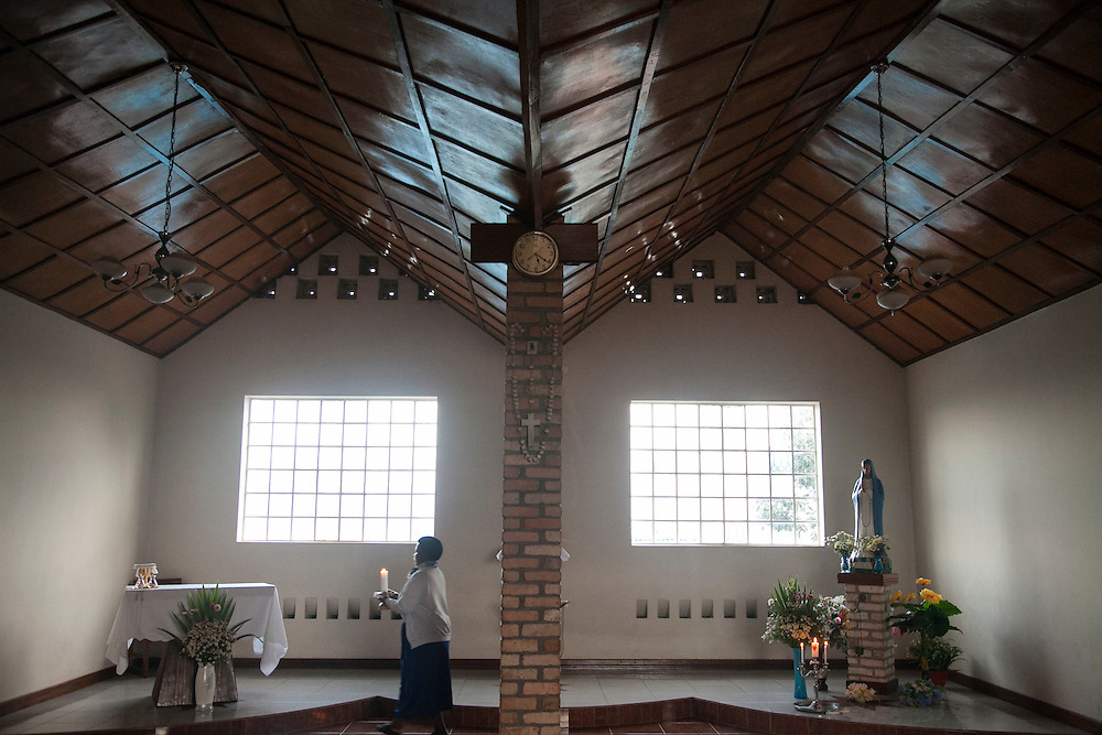 The Shrine of Our Lady of Sorrows in Kibeho, Rwanda, is the only sanctioned Marian sanctuary in Africa. Kibeho's overseers and the Rwandan government hope this place will become a top tourism site. <br /> <br /> This chapel is where the three young visionaries slept when the building was a dorm. The Mary statue is where Alphonsine Mumureke's bed was, the sacristy (behind column) is where Nathalie Mukamaimpaka's bed was, and the altar is where Marie Claire Mukangango's bed was.<br /> <br /> Photographed on Saturday, October 25, 2014.<br /> <br /> Photo by Laura Elizabeth Pohl