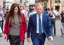 © Licensed to London News Pictures. 09/08/2018. Bristol, UK. BEN STOKES with his wife CLARE RATCLIFFE leaves Bristol Crown court at lunchtime today for the fourth day of his trial on charges of affray that relate to a fight outside a Bristol nightclub on September 25 2017. England cricketer Ben Stokes and two other men, Ryan Ali, 28, and Ryan Hale, 27, all deny the charge. Stokes, Ali and Hale are jointly charged with affray in the Clifton Triangle area of Bristol on September 25 last year, several hours after England had played a one-day international against the West Indies in the city. A 27-year-old man allegedly suffered a fractured eye socket in the incident. Photo credit: Simon Chapman/LNP