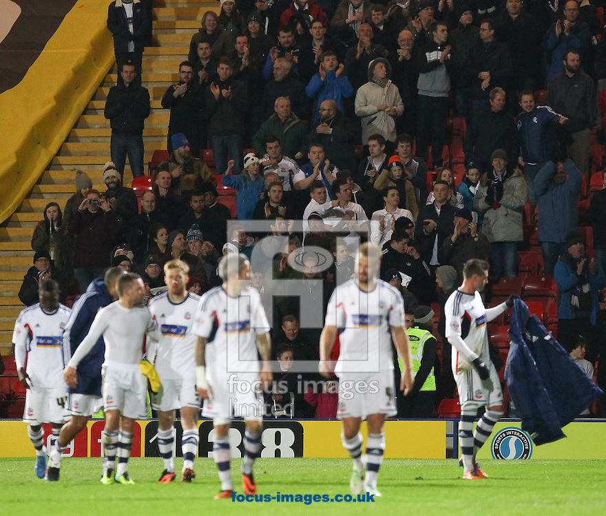 Picture by John Rainford/Focus Images Ltd +44 7506 538356<br /> 23/11/2013<br /> Bolton Wanderers fans applaud their team after the Sky Bet Championship match at Vicarage Road, Watford.