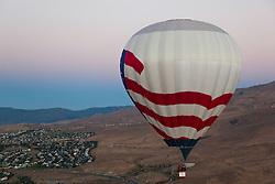 """Dawn Patrol 17"" - Photograph of a hot air balloon flying for the Dawn Patrol at the 2012 Great Reno Balloon Race. Photographed from a hot air balloon."