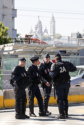 © Licensed to London News Pictures . 09/05/2017. Paris, France . Police at the scene where French police have cleared approximately 1000 people from an ad hoc roadside camp under roadways along a central reservation , in which migrants were living , in Porte de la Chapelle in North Paris , this morning (9th May 2017) . Photo credit: Joel Goodman/LNP