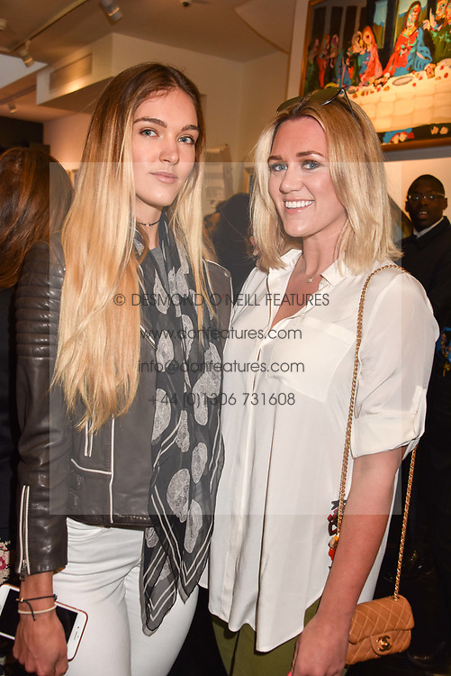 Left to right, Lorna Florence and Jessica Titcumb at a private view of work by Bradley Theodore entitled 'The Second Coming' at the Maddox Gallery, 9 Maddox Street, London England. 19 April 2017.