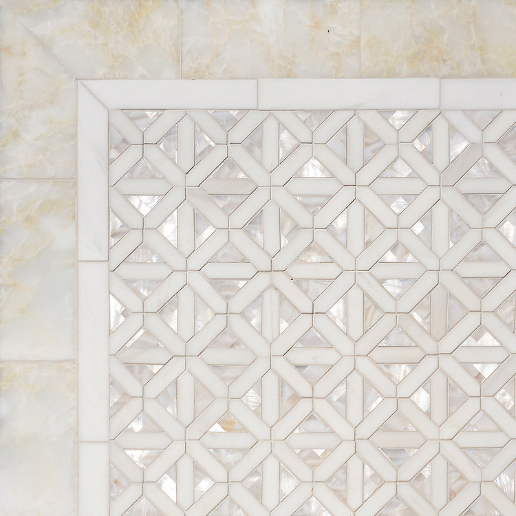 Joie, a waterjet mosaic shown in polished Cloud Nine, Dolomite and Shell, is part of the Aurora® collection by New Ravenna.