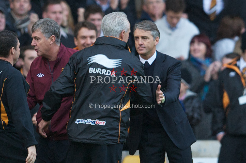 WOLVERHAMPTON, ENGLAND - Saturday, October 30, 2010: Manchester City's defeated manager Roberto Mancini shakes hands with Wolverhampton Wanderers' manager Mick McCarthy after his side's 2-1 defeat during the Premiership match at Molineux. (Pic by: David Rawcliffe/Propaganda)