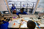 Diamond polishers speak to their supervisors at Namcot Diamonds, a diamond cutting and polishing company in Windhoek, Namibia. Diamonds are one of Namibia's major exports, and  while conflict diamonds grab the headlines, the fact is that the industry does provide a fairly decent living for many.